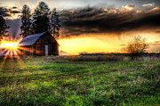 Barn Yard Photo Prints - Mountain Sun behind Barn Print by Derek Haller