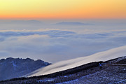 Snow Landscapes Framed Prints - Mountains clouds at sunset Framed Print by Guido Montanes Castillo