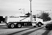 Winter Roads Prints - municipal city dump truck taking away snow cleared from parking lots and roads in Saskatoon Saskatch Print by Joe Fox