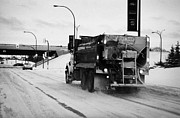 Winter Roads Prints - municipal city truck spreading grit and salt on roads in Saskatoon Saskatchewan Canada Print by Joe Fox