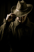 Dark Photo Posters - Mysterious man in hat and trench coat Poster by Edward Fielding