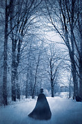 Snowy Evening Posters - Mysterious man with cape walking through the snow Poster by Sandra Cunningham