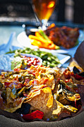 Restaurant Prints - Nacho plate and appetizers Print by Elena Elisseeva