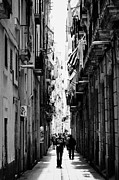 Narrow Streets Prints - narrow streets in the el raval district of cuitat vella Barcelona Catalonia Spain Print by Joe Fox