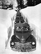 Winter Roads Prints - Narrow Winter Road Print by Underwood Archives