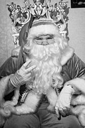 Father Christmas Prints - nasty Santa sitting on his throne holding two fingers up in grotto set up Print by Joe Fox