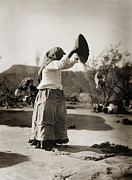 Edward Curtis Framed Prints - Native American Papago Woman Cleaning Wheat Framed Print by The  Vault