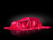 Shiny Fabric Framed Prints - New car model under red covering Framed Print by Oleksiy Maksymenko