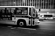 Manhatten Framed Prints - New York MTA city bus speeding along 34th street usa Framed Print by Joe Fox