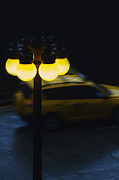 Paved Street Prints - Night Taxi Print by Margie Hurwich