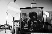 Murals Photo Prints - No entry roadsign and The petrol bomber at the Battle of the Bogside part of the peoples gallery murals in Rossville Street of the bogside area of Derry Londonderry Print by Joe Fox