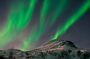 Pulsating Posters - Northern lights above mountain top Poster by Strahil Dimitrov