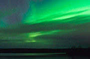 Pulsating Prints - Northern lights behind clouds Print by Strahil Dimitrov