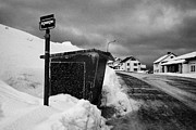 Honningsvag Prints - norwegian bus stop shelter covered in snow by the side of the road Honningsvag finnmark norway europ Print by Joe Fox