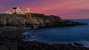 Nubble Lighthouse Prints - Nubble Lighthouse At Sunset Print by Susan Candelario