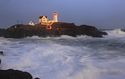 Cape Neddick Lighthouse Posters - Nubble Lighthouse Holiday Lights and High Surf Poster by John Burk