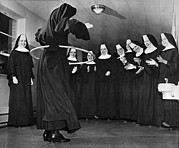 Clapping Metal Prints - Nun Swivels Hula Hoop On Hips Metal Print by Underwood Archives