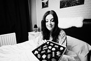 Offer Framed Prints - Offering Chocolates To Early Twenties Woman In Bed In A Bedroom Framed Print by Joe Fox