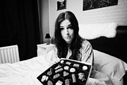 Apology Framed Prints - Offering Chocolates To Sceptical Early Twenties Woman In Bed In A Bedroom Framed Print by Joe Fox