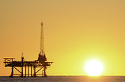 Sea Platform Framed Prints - Offshore Oil Rig And Sun Framed Print by Bradford Martin