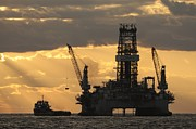 Oil Rigs Prints - Offshore Rig At Dawn Print by Bradford Martin