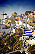 Caves Posters - Oia and a greek flag Poster by Meirion Matthias
