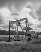 Pumping Oil Framed Prints - Oil Pump Jack in Black and White photography Framed Print by Ann Powell