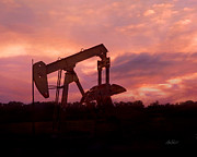 Pumping Oil Framed Prints - Oil Pump Jack Sunset Framed Print by Ann Powell