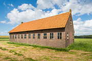 Old Barn In A Rural Landscape With A Blue Sky And White Clouds. Print by Ruud Morijn