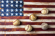 Folk Art American Flag Photos - Old baseballs on folk art flag by Garry Gay