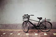Wall Street Pyrography Prints - Old Bicycle against a Wall Print by Thanapol Kuptanisakorn
