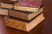 Dark Wood Table  Prints - Old Books on Dark Wood Background Print by Colin and Linda McKie