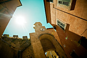 Brick Buildings Pyrography Prints - Old Clock On The Tower And Sun Print by Raimond Klavins