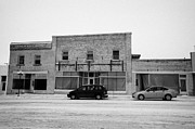 Sask Prints - old empty stores brick historic buildings 3rd ave Kamsack Saskatchewan Canada Print by Joe Fox