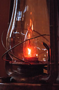 Hurricane Lamp Photos - Old fashioned lantern in darkness.   by Alexandr Grichenko
