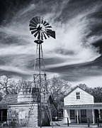 Water Mill Images Prints - Old fashioned windmill and wooden cistern Print by Alan Tonnesen