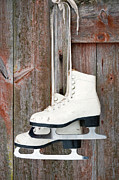 Skates Prints - Old figure ice skates on a rustic wooden wall Print by Anna-Mari West