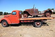 Old Trucks Photos - Old Flatbed Truck Towing The Old Jalopy 5D23963 by Wingsdomain Art and Photography