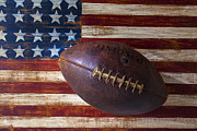 Stitching Prints - Old Football On American Flag Print by Garry Gay