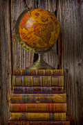 Leather Books Posters - Old globe on old books Poster by Garry Gay