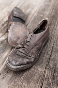 Child Prints - Old leather shoes on wooden floor Print by Edward Fielding