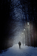 Snowy Night Art - Old man walking on snowy winter path at night by Sandra Cunningham