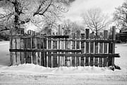 Conditions Posters - old patched up wooden fence using old bits of wood in snow Forget Saskatchewan  Poster by Joe Fox