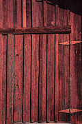 Knothole Prints - Old red barn door Print by Garry Gay