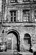 Old Krakow Framed Prints - Old Red Brick Crumbling Building In Kazimierz District With Plaster Facade Removed To Expose Brickwork Krakow Framed Print by Joe Fox