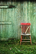 Sandra Cunningham - Old red chair near a barn/digital oil painting