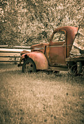 Weathered Prints - Old red farm truck Print by Edward Fielding