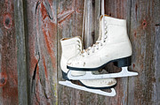 Figure Skates Prints - Old skates hanging on a wooden wall Print by Anna-Mari West