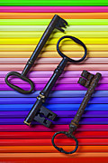 Color Pencils Prints - Old skeleton keys on rows of colored pencils Print by Garry Gay