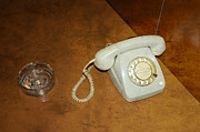 Times Past Prints - Old telephone and ashtray on brown table Print by Matthias Hauser